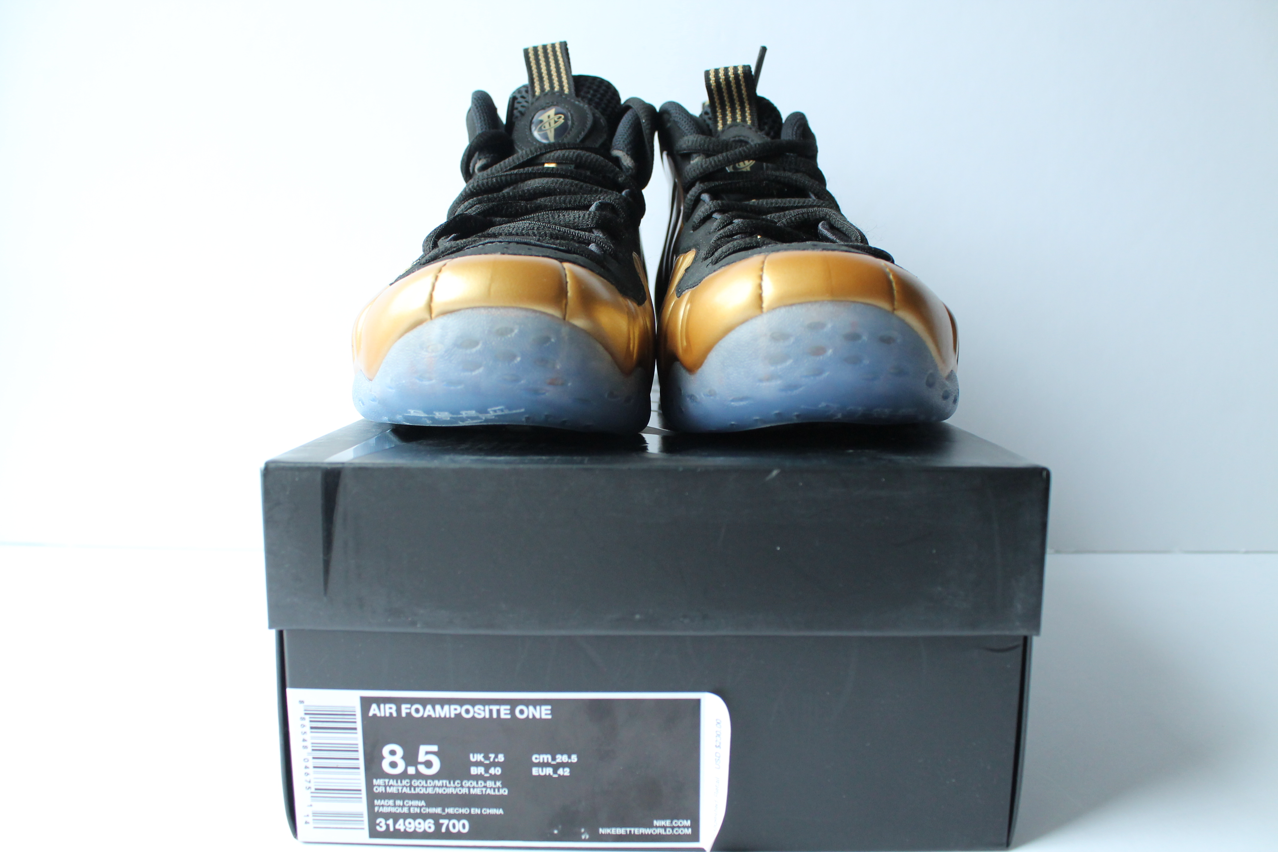 big sale fb29c 69179 Nike Air Foamposite One Gold ...