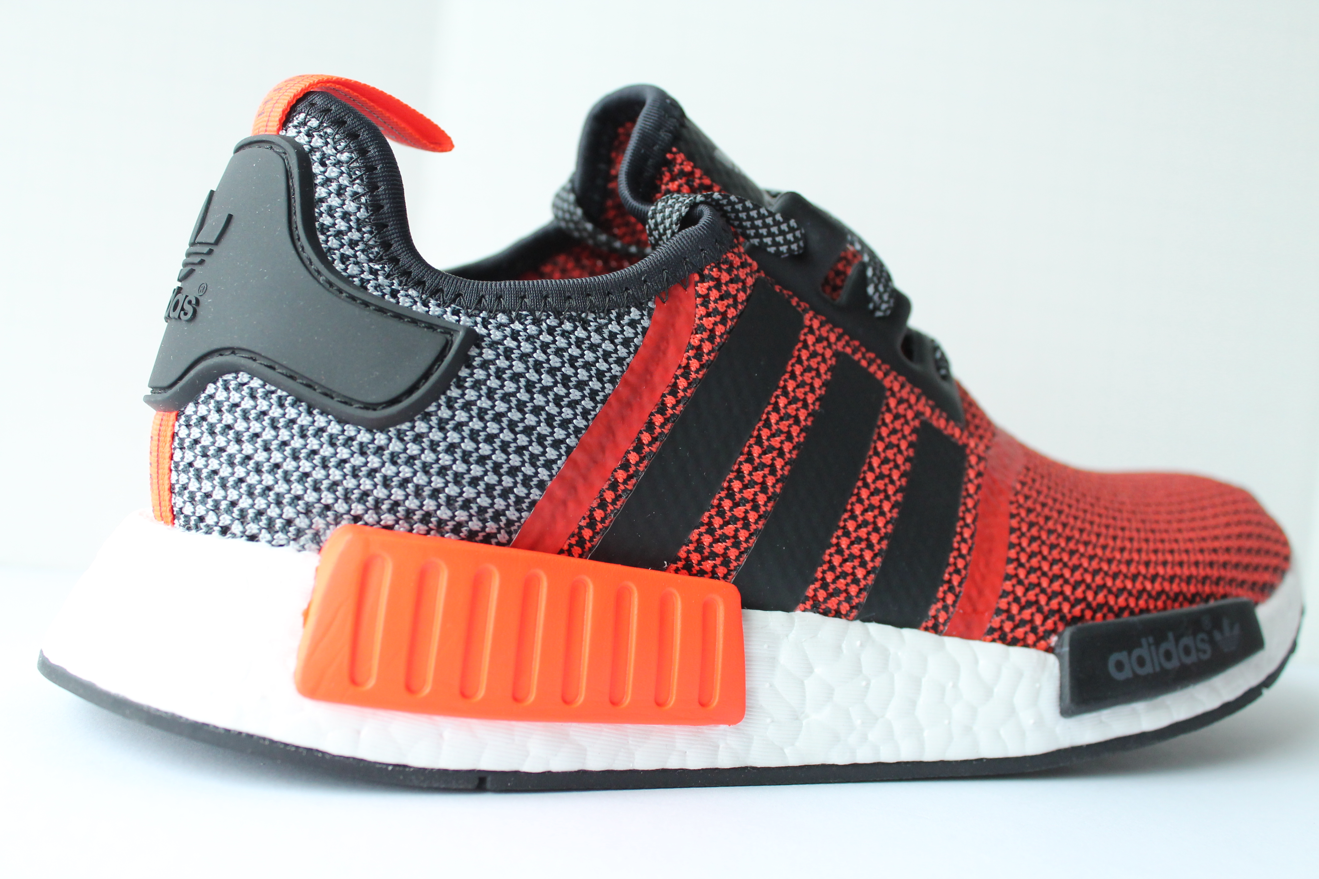 ea0d6517a ... Adidas NMD R1 – Red Vinyl ...